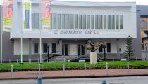 ECONOMISCHE TERUGVAL LEIDT TOT MINDER WINST BIJ SURINAAMSCHE BANK NV